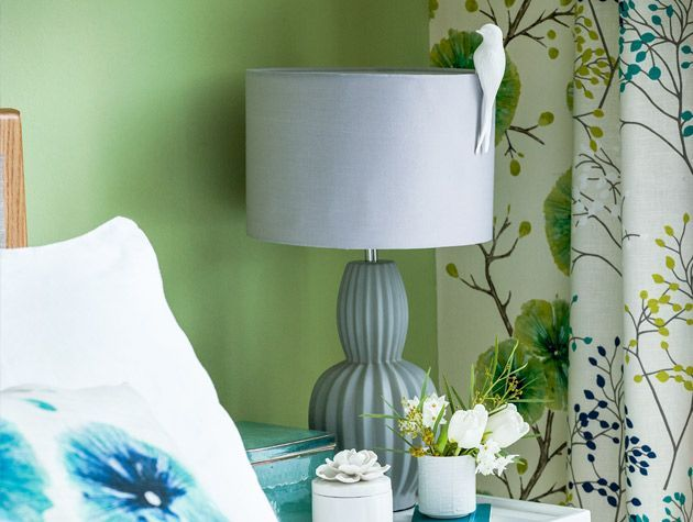Freshen up your bedroom with oversized flower prints in green and teal 2