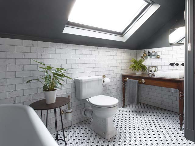 a bathroom makeover featured in  good homes featuring a vintage bath, plants, antique furniture and metro tiles