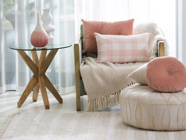 pared back style living room with mint green arm chair and blush pink cushions