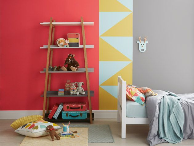 red yellow blue geometric painted walls in kids bedroom crown paints
