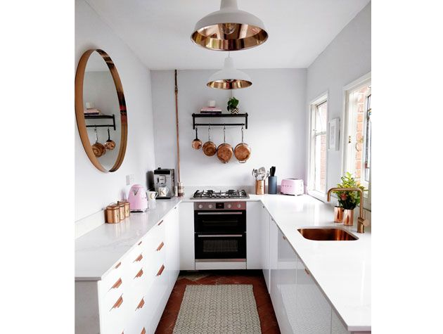 u shaped white kitchen with copper accents and copper utensils