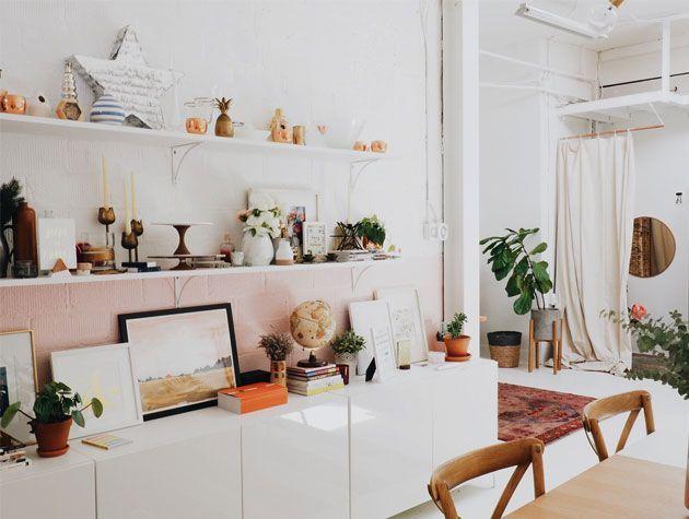 dining area with white interior decor and decorative ornament shelf