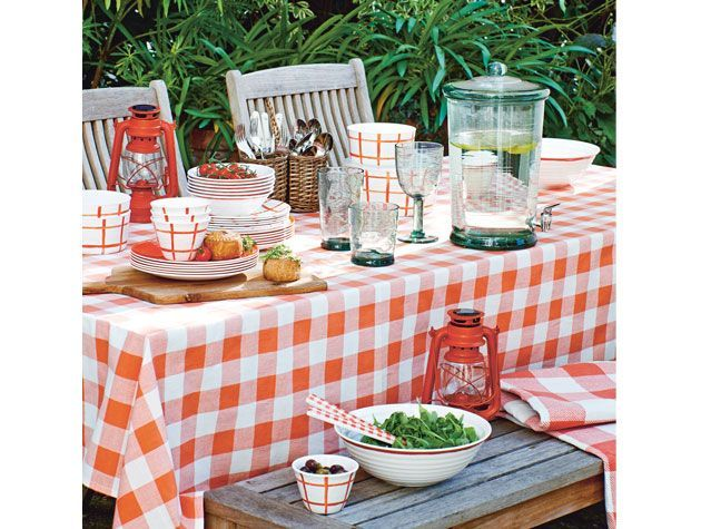 outdoor garden dining table with red andwhite gingham table cloth al fresco