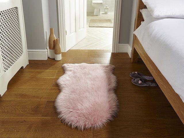 Pink sheepskin rug in ensuite bedroom -the-rug-seller-living-room-goodhomesmagazine.com