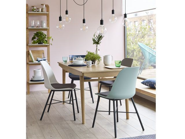 Dining room with hanging light pendant and flowers on dining table -living-room-goodhomesmagazine.com