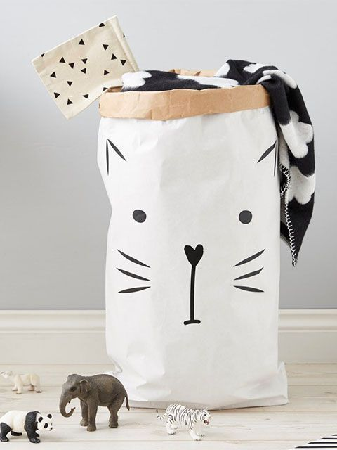 Black and white laundry bag with an illustrated cat face on the front