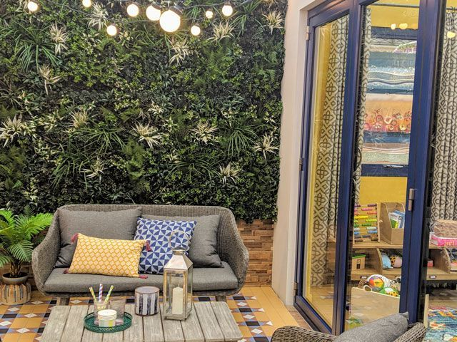 living wall in outdoor area plants and moroccan tile flooring in good homes roomsets at ideal home show 2019