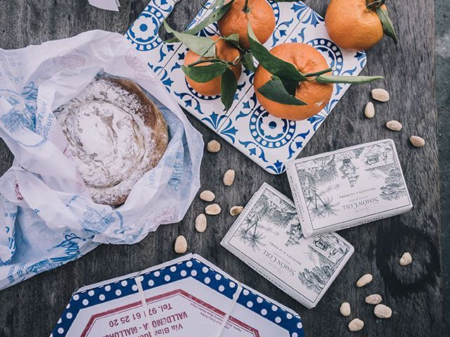 oranges and bread on a rustic table
