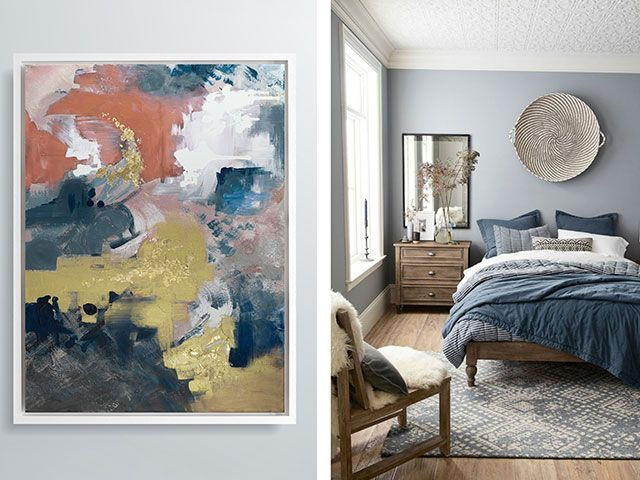 A blue bedroom with bold abstract artwork