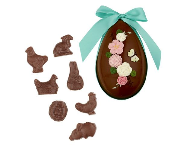 A Fortnum & Mason milk chocolate Easter egg, with hand decorated pink and white flowers, topped with a blue bow -shopping-goodhomesmagazine.com