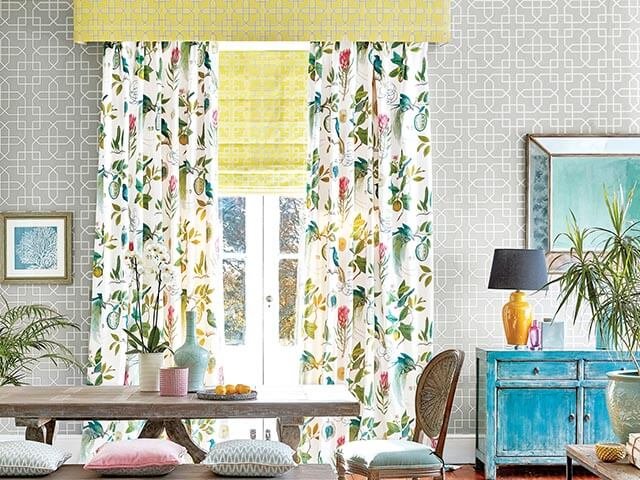 tropical long curtains with matching blinds and pelmet in rustic living room dining room - curtain ideas - sanderson - goodhomesmagazine.com