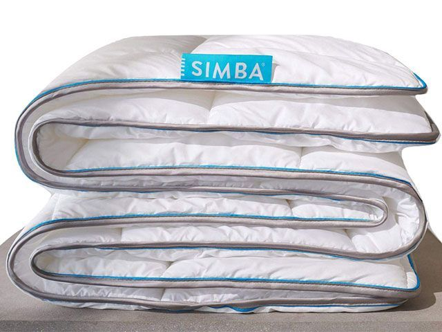 Folded king size white summer duvet with blue piping
