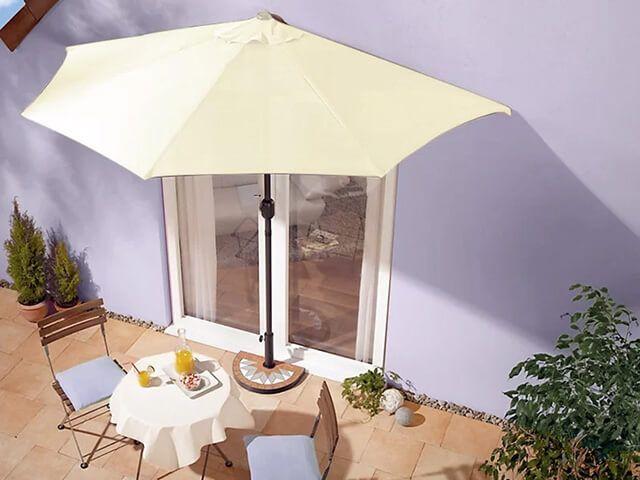semi-parasol against building over garden furniture - wayfair - best parasol - goodhomesmagazine.com