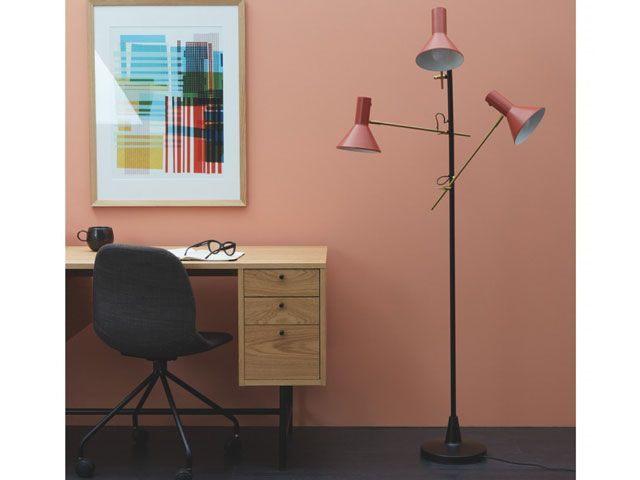 habitat nyx red floor lamp with black by a desk in a study/office