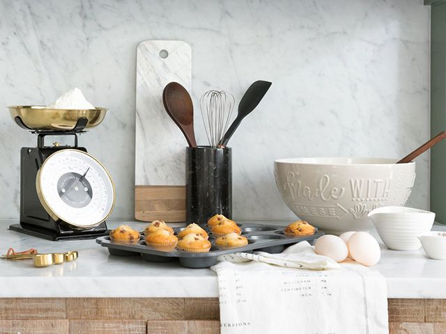 Amara black and brass kitchen scales with mixing bowl and utensils - goodhomesmagazine.com