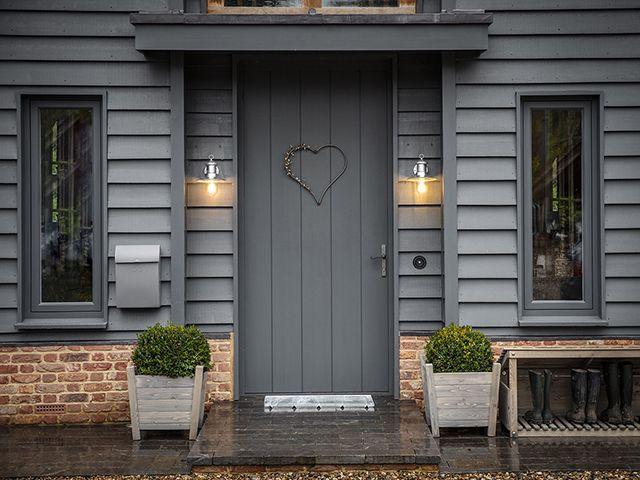 modern front garden with dark grey walls and door and outdoor lighting from Garden Trading - goodhomesmagazine.com