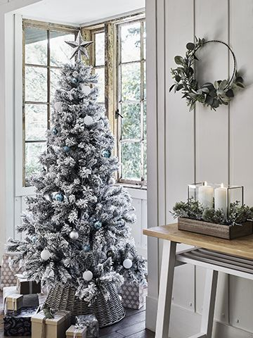 argos scandi look in a white painted wood clad living room with bay window - our top high street Christmas tree looks - inspiration - goodhomesmagazine.com