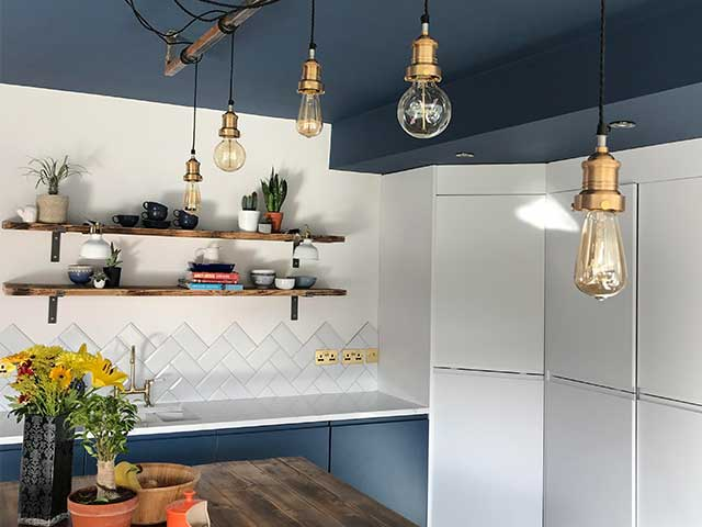 hanging lights, wooden shelves and white tiled farmhouse kitchen, goodhomesmagazine.com