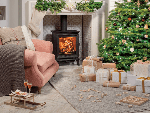 Woodburning stove with Christmas tree and decorations copy