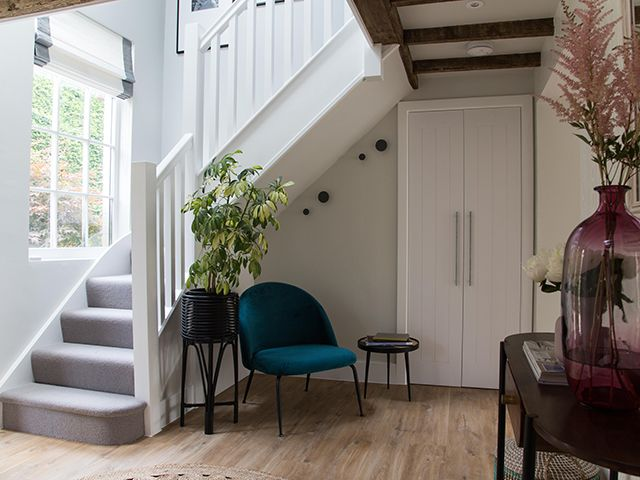 cult furniture hallway with chair and stairs - goodhomesmagazine.com