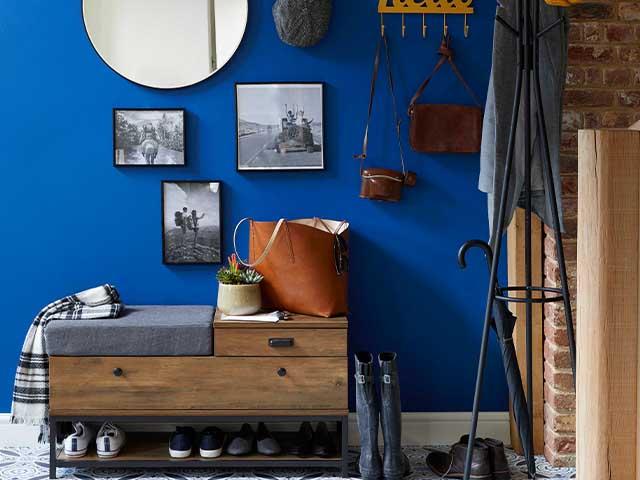 dunelm blue hallway gallery wall - budget hallway updates we love - hallway - goodhomesmagazine.com