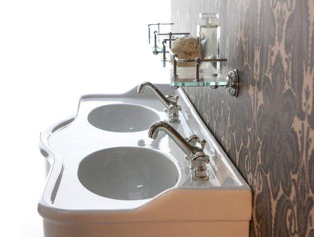 two basins on top of a bathroom vanity unit