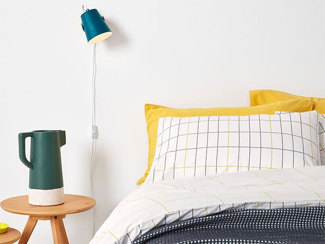wall mounted light next to bed - goodhomesmagazine.com