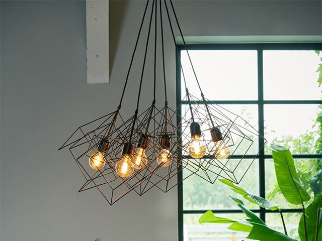 black caged chandelier - 5 chandeliers to suit every interior style - shopping - goodhomesmagazine.com