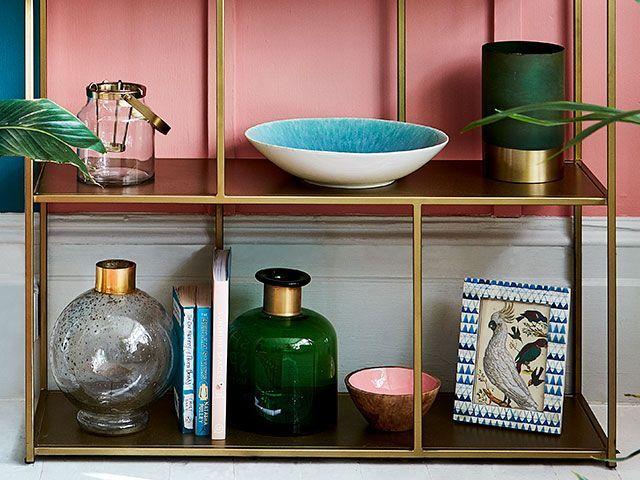 bottom of shelf with different shaped vases - goodhomesmagazine.com