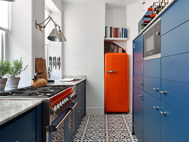 Galley kitchen ideas | Tiled galley kitchen with blue cabinetry and SMEG fridge | Image: Neptune | Good Homes Magazine
