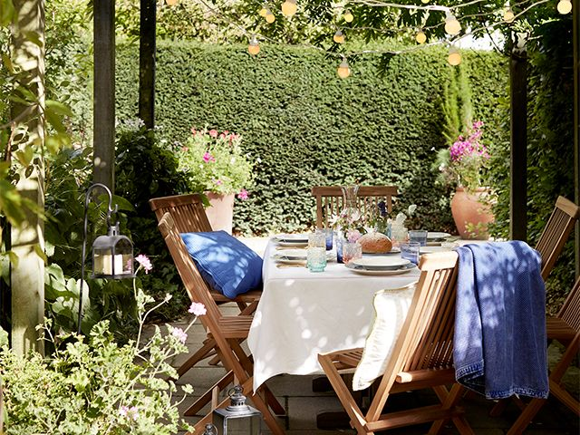 summer garden seating - how to save on your electricity bills while working from home - inspiration - goodhomesmagazine.com
