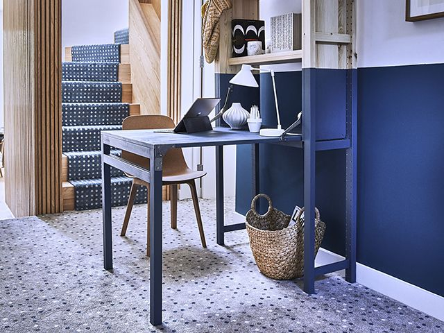 hallway with makeshift desk office painted in blue - goodhomesmagazine.com
