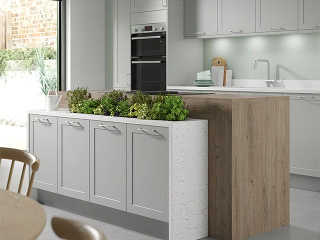 grey island kitchen planter - how to bring the outside in with an island planter - kitchen - goodhomesmagazine.com