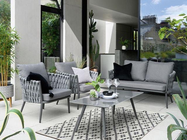 grey outdoor garden space - 6 stylish al fresco dining ideas - garden - goodhomesmagazine.com