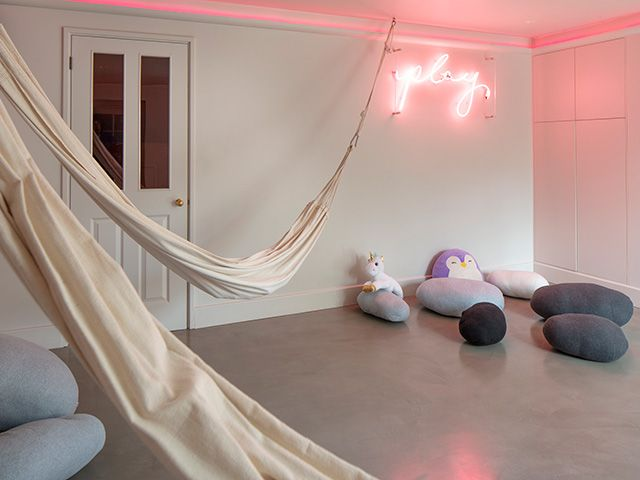 childrens playroom with neon sign - home tour - goodhomesmagazine.com