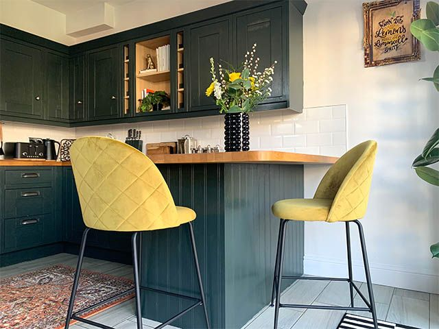 teal kitchen with yellow stools - design ideas for incorporating a breakfast bar into your kitchen - kitchen - goodhomesmagazine.com