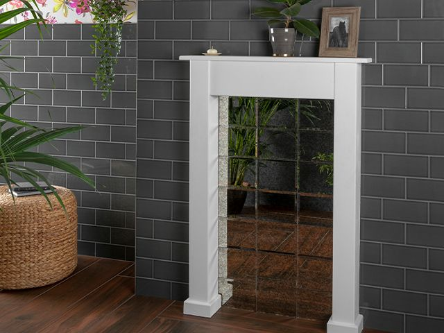 fireplace with mirrored tiled - 7 ways to update your living room for free - living room - goodhomesmagazine.com