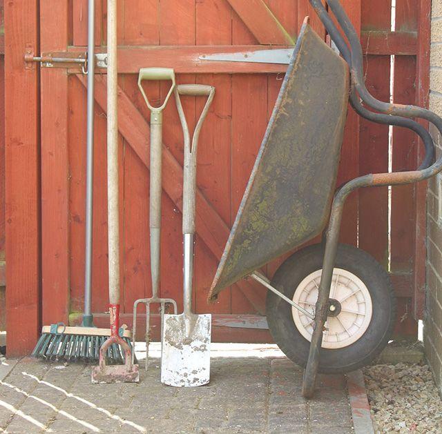 garden tools and wheel barrow - goodhomesmagazine.com