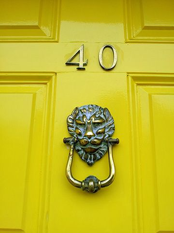 yellow door - how to incorporate reclaimed materials in your home - inspiration - goodhomesmagazine.com