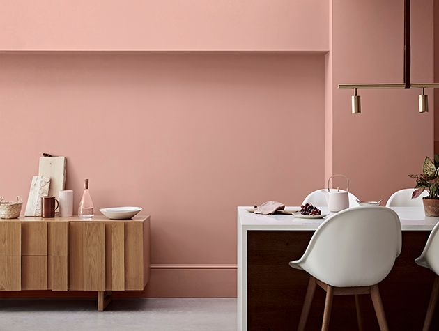 modern furniture in front of wall painted pink