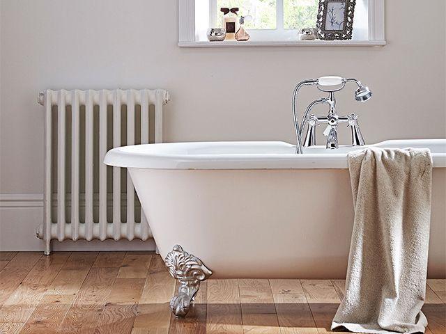 white bathroom wooden flooring - 5 creative white bathroom ideas - bathroom - goodhomesmagazine.com