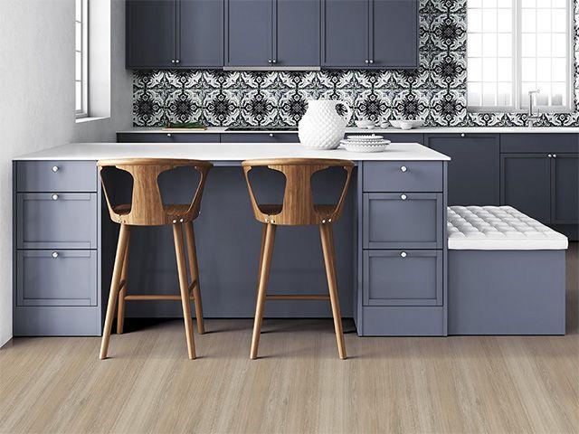 wooden flooring in a blue kitchen - goodhomesmagazine.com