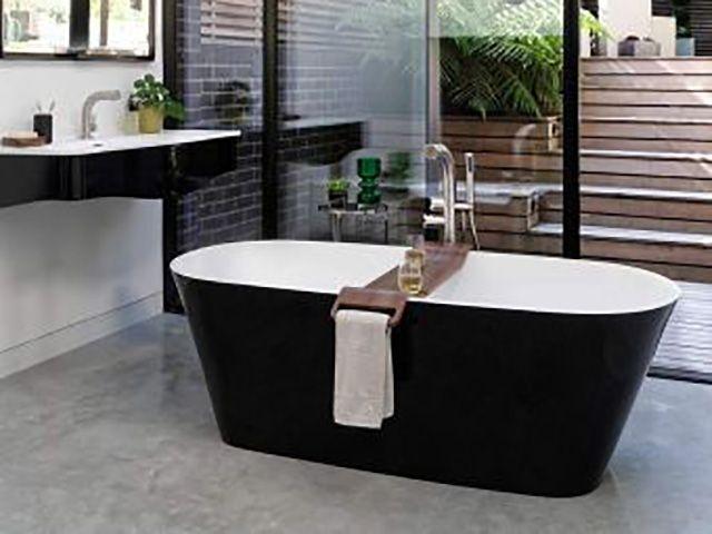 stylish black double ended bath in bathroom - goodhomesmagazine.com