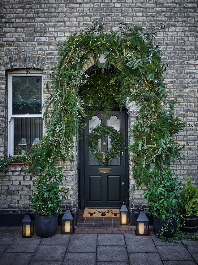 christmas front door with foliage arch - garden - goodhomesmagazine.com