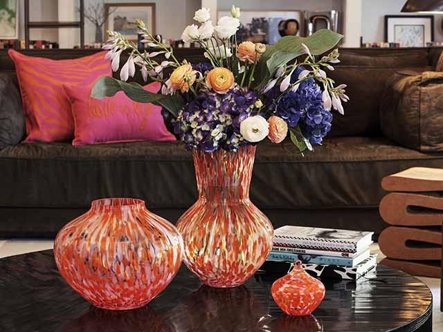 Bright colourful Diane von Furstenburg vase in black living room with bright accessories, goodhomesmagazine.com