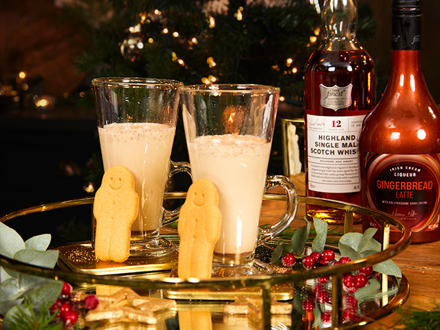 Gingerbread latte liqueur served in a latte glass, with mini gingerbread men - christmas cocktail recipes - goodhomesmagazine.com