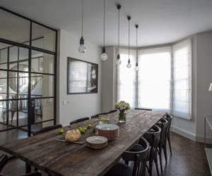 large dining table and chairs, pendant lighting, bay window and crittall-style doors