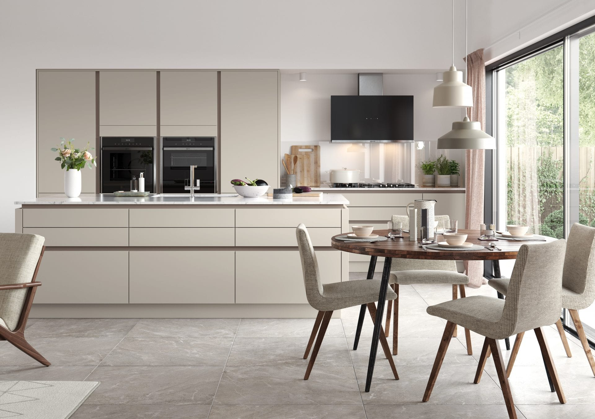 modern fitted kitchen in pale colours, dining table and chairs