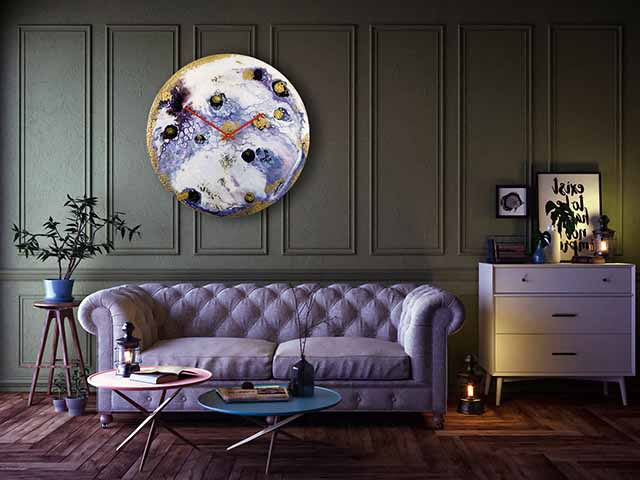 Elegant glass wall clock on panelled wall with retro pincushion settee and side tables in shot, goodhomesmagazine.com