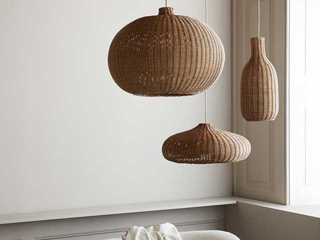 Three different shaped rattan lampshades hanging from the ceiling of a room painted in neutral tones - Rattan - Goodhomesmagazine.com